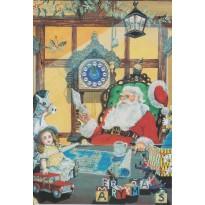Père Noël à grande barbe blanche et lorgnons assis dans son fauteuil