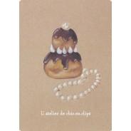 Religieuse au chocolat, patisserie-bijou sur carte postale